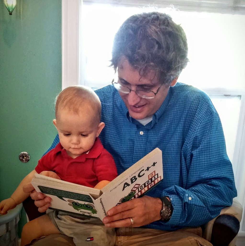 Image of Me reading a book to my son